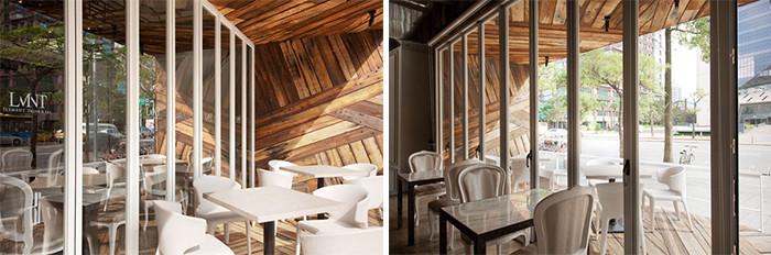 文章导读:就象是人与人之间的个性差异,由每位设计师根据业主需求所设定营造的餐饮空间,也有着各自的个性,在幽藏的内敛与吸睛的张狂之间,该怎么选择最适合自己或另一半的约会地点呢?今天郑州餐厅设计公司勃朗设计小编为您带来的是时尚用餐空间张狂不羁美式餐厅装修设计效果图!  本案从门口开始呈现的就是张狂不羁的设计口语,用木头质材所拼贴出纵横交错的野性线条,在光影的错落下更显得富有层次与深浅,简练质感的白色屏风状门窗,却又在入内后开啓另一道视野。纵向多面的开窗手法,不仅让坐在窗边的客人选择着呼吸,也能让整间店面在白